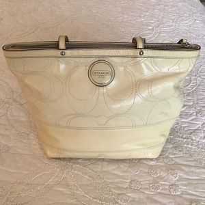 Coach Cream Patent Leather Tote.